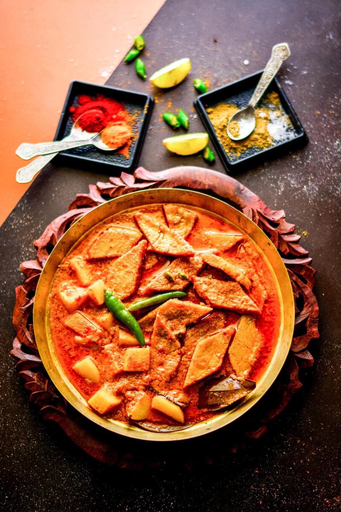 Niramish Dhokar Dalna / Bengali Style Fried Lentil Cakes in Tomato Curry
